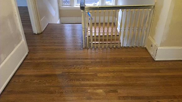 Older floor in Royal Oak after Refinishing. Dura Seal chestnut stain color and water based satin finish used.