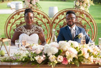 Newly Wed Couple Sitting at Reception Table - Wedding Coordinator Atlanta at Kris Lavender