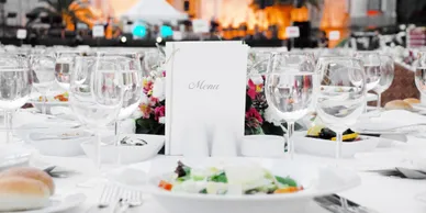 Table with Wine Glasses and a Menu - Party Catering Services Los Angeles by Panzarello Catering