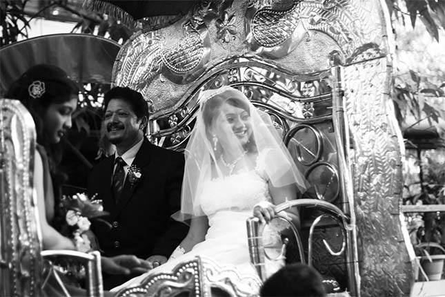 Karen arrives at the church with her father, on a chariot