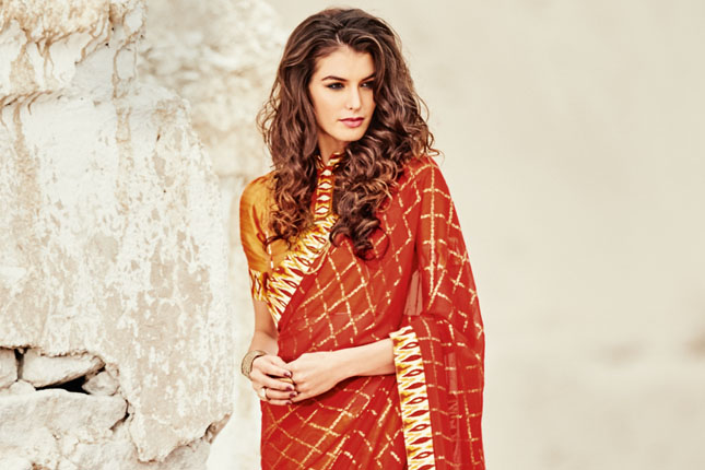 631c66eab0 So, if you want to make a statement this New Year, red is the way to go,  and we have handpicked 10 ravishing red sarees ...