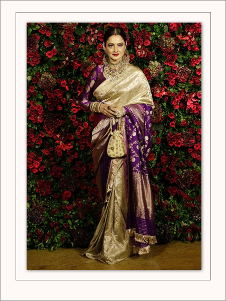 fb3a5817766dc0 Not many can pull off a colour like purple. But we can count on Rekha to  pull this off. She makes the purple saree look royal with her hair neatly  rolled ...