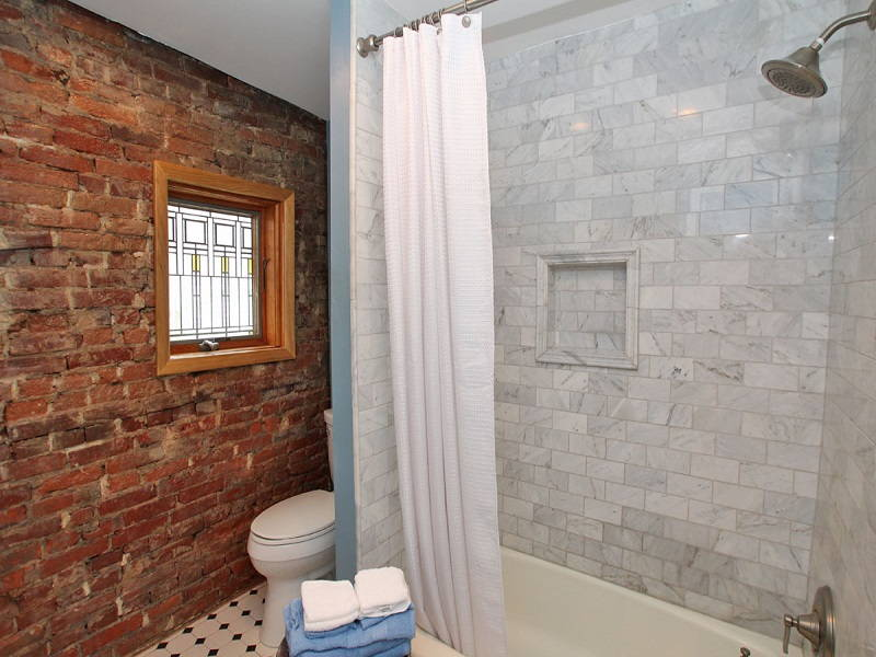 Brick wall bath tub
