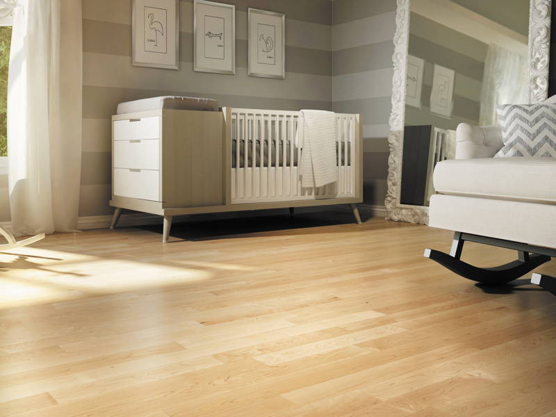 baby room with hardwood floor