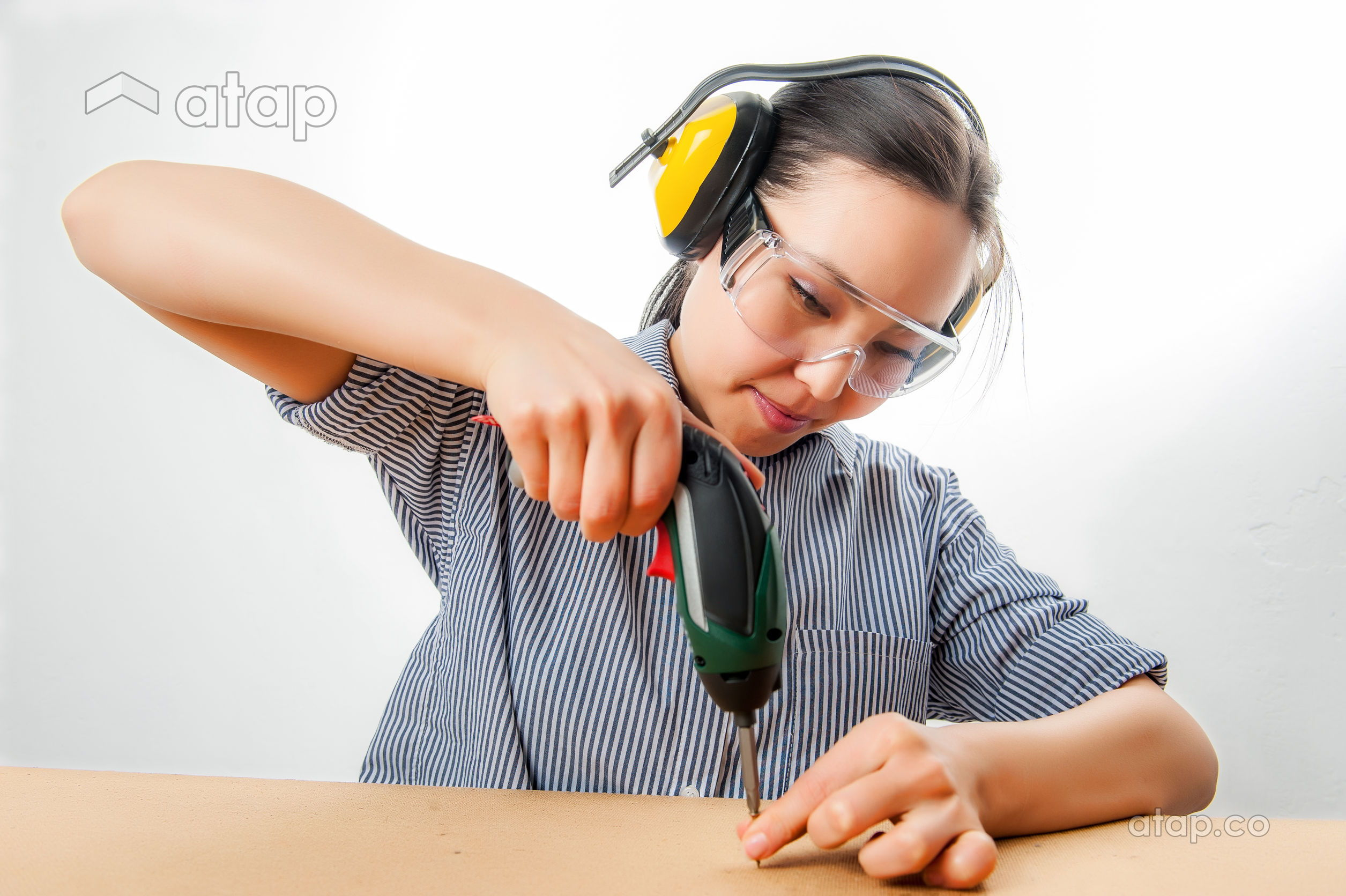 woman using drill