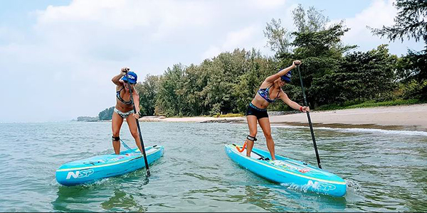 where-to-go-to-make-your-workout-extra-fun-paddle-boarding-two