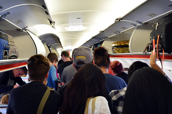 airplane-hacks-for-long-flights-hang-back-during-boarding