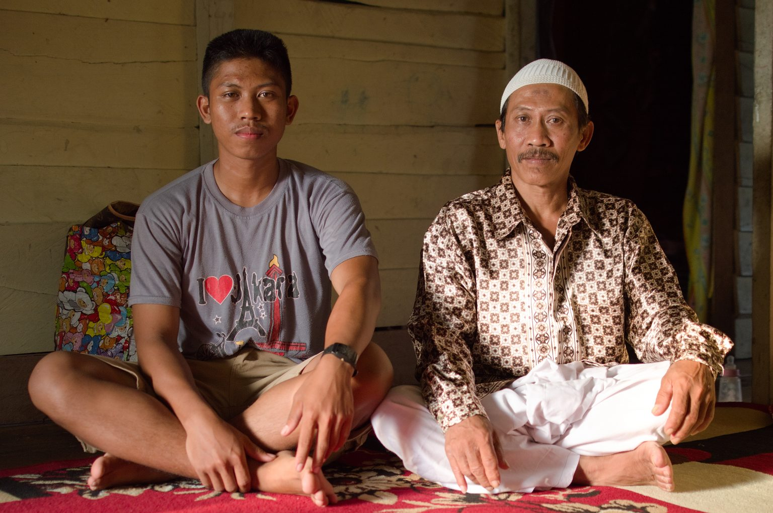 Pak Didin and his son Ruslin who received a scholarship to study optometry in Jakarta