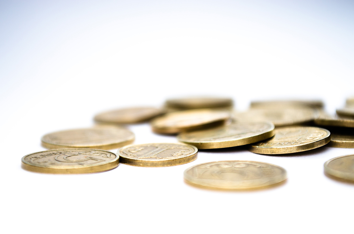 coins on white table - money management