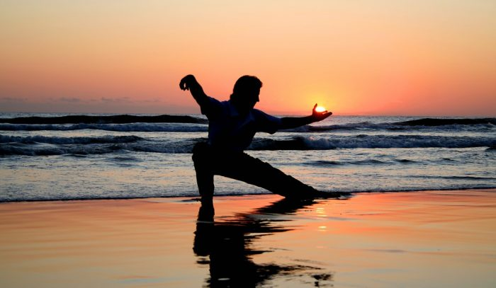 taichi at the beach sunset/sunrise