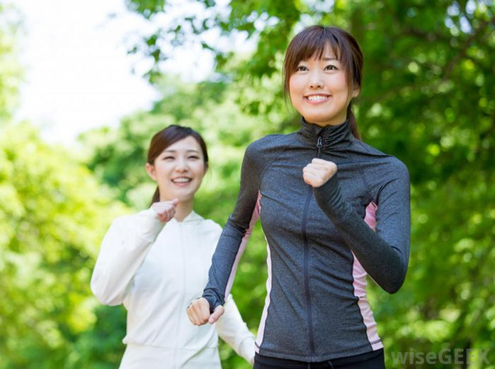 asian women running/walking