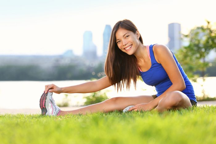 exercise-woman-stretching-field