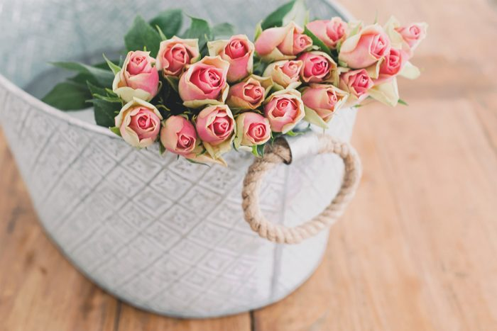beautiful pink roses in a basket