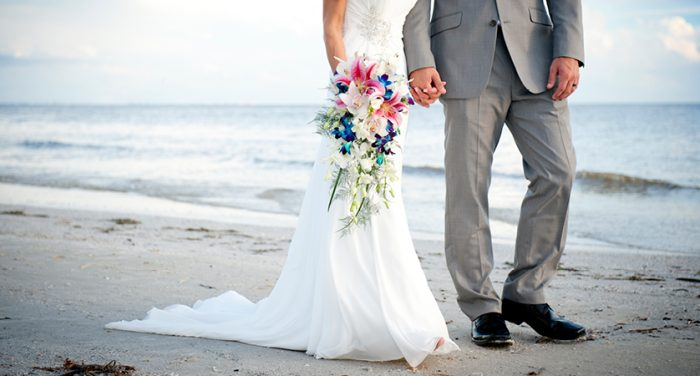 wedding couple at beach - sunstream
