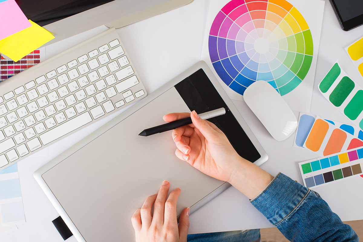 Graphic designer sketching something with colour wheel