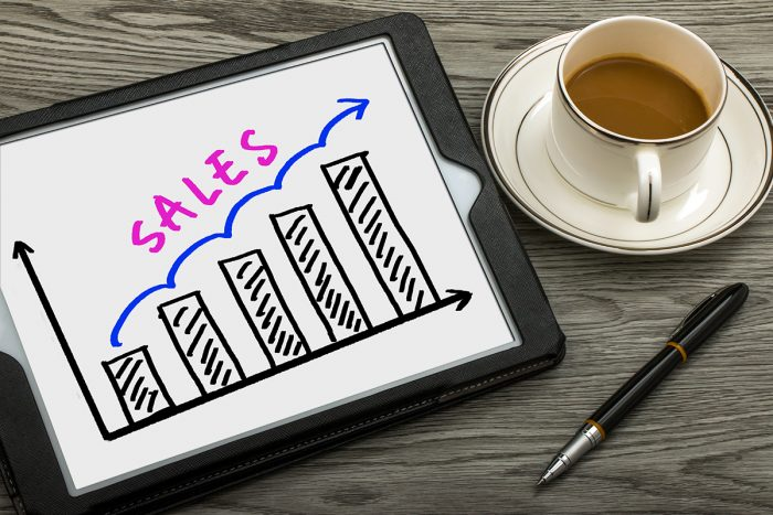 sales graph concept hand drawing on tablet pc