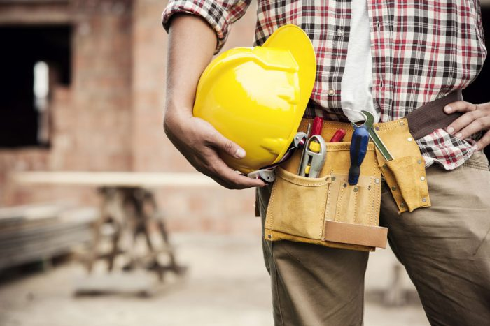 contractor with yellow hard hat