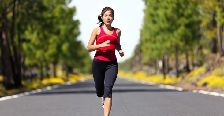 Sport fitness running woman jogging during outdoor workout. Beautiful young female athlete runner training for marathon on forest road in spring or summer. Mixed race Asian woman fitness model.; Shutterstock ID 97819907; PO: aol; Job: production; Client: drone
