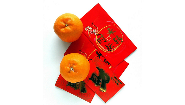 red packets (angpow) with Mandarin oranges