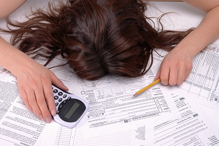 woman stressed out by taxes
