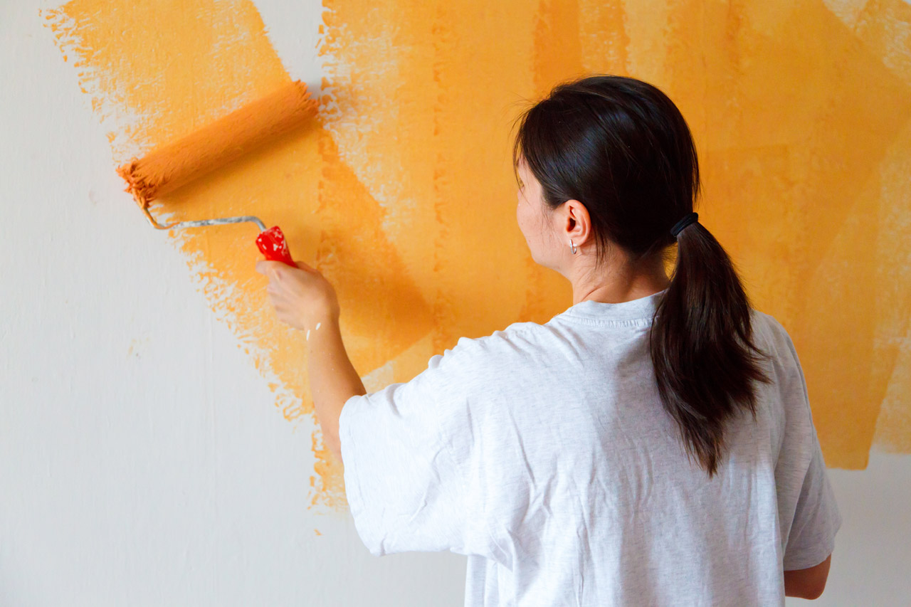asian lady painting wall