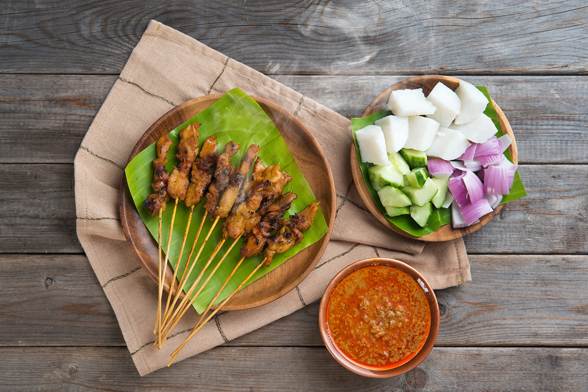 Hot and spicy Asian dish. Delicious chicken sate or satay, skewered and grilled meat, served with peanut sauce. Fresh cooked with steamed and smoke.