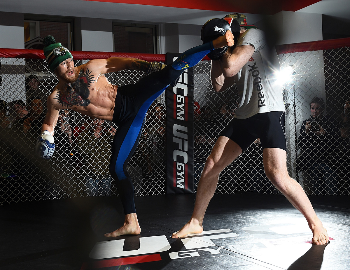 BOSTON, MA - JANUARY 15: UFC featherweight Conor McGregor of Ireland (L) holds an open training session for the media and fans at UFC Gym on January 15, 2015 in Boston, Massachusetts. (Photo by Jeff Bottari/Zuffa LLC/Zuffa LLC via Getty Images)