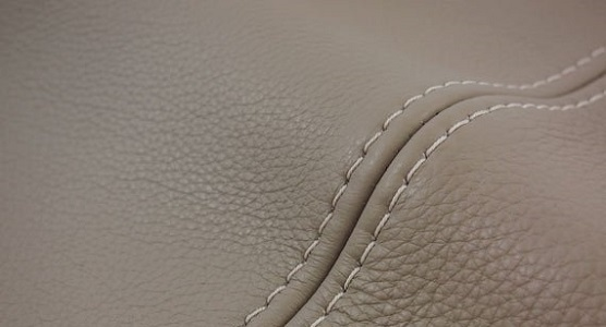 inspect the leather sofa stitching