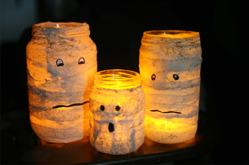 Image Credit: Reader's Digest https://www.rd.com/wp-content/uploads/2016/08/04-kids-halloween-crafts-mummy-candle.jpg