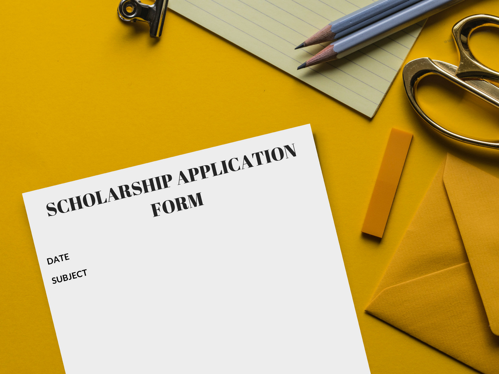 college scholarships application letter on a yellow table