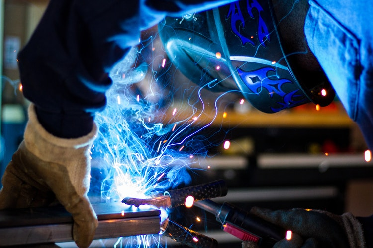 man working on a welding