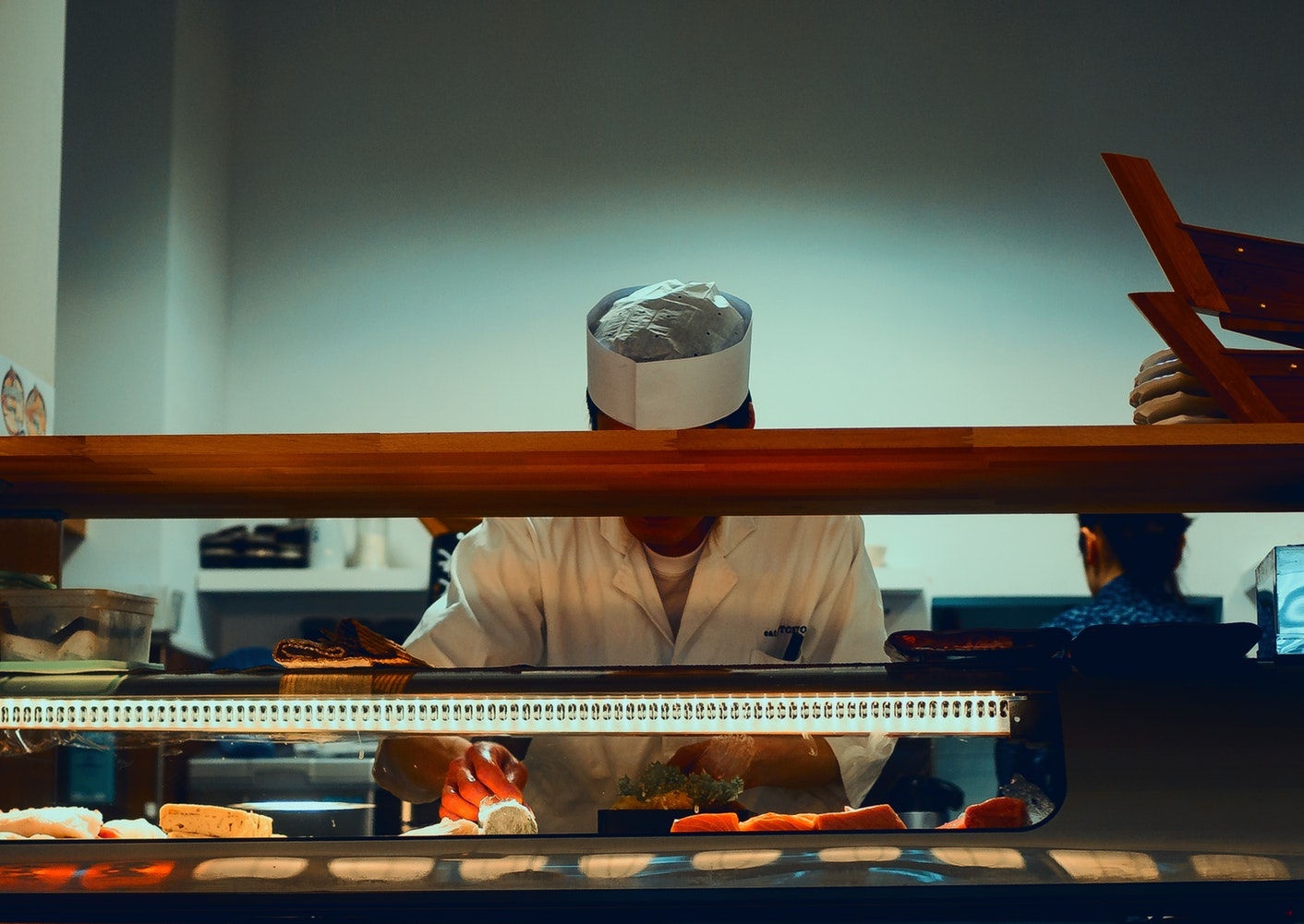 man preparing food on a kitchen restaurant