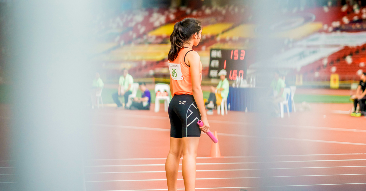 female athlete standing on a track