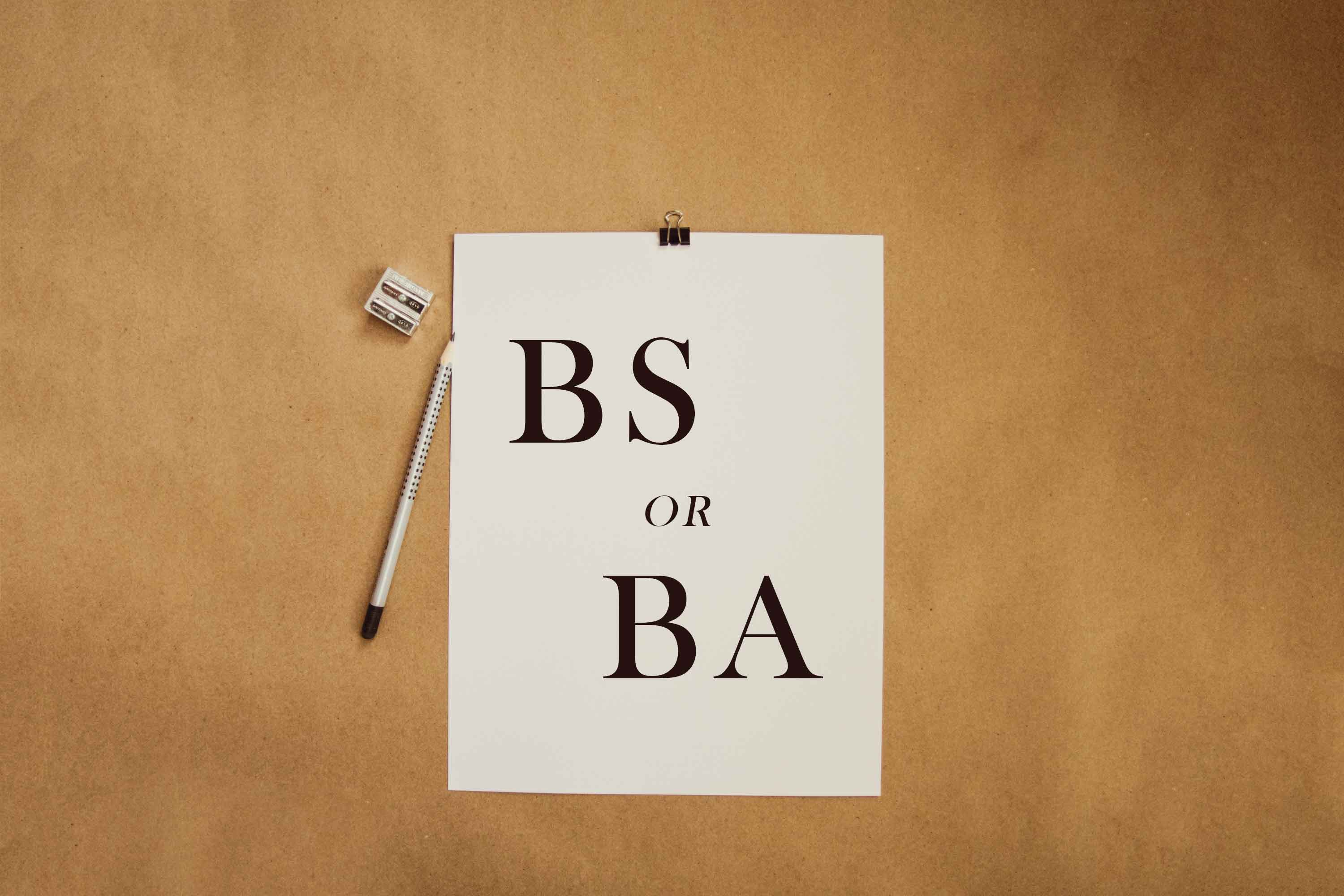 "paper and pen with a note written ""BS or BA"""