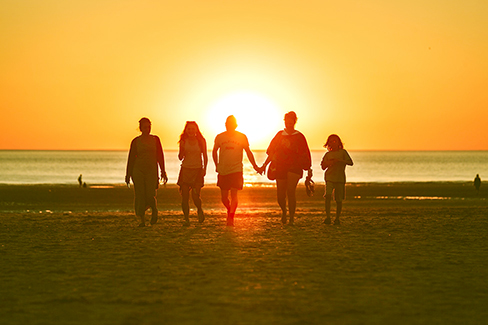 Silhouette of family on a sunset background