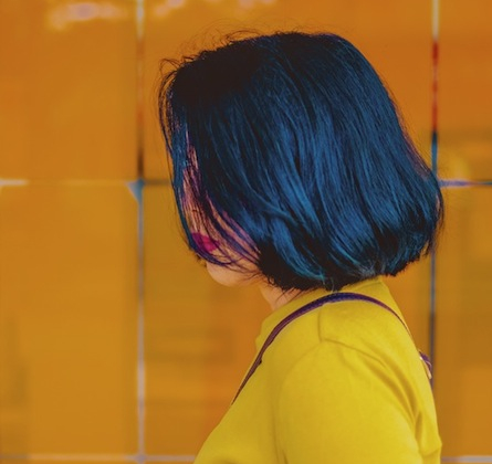 side view of woman with short blue hair