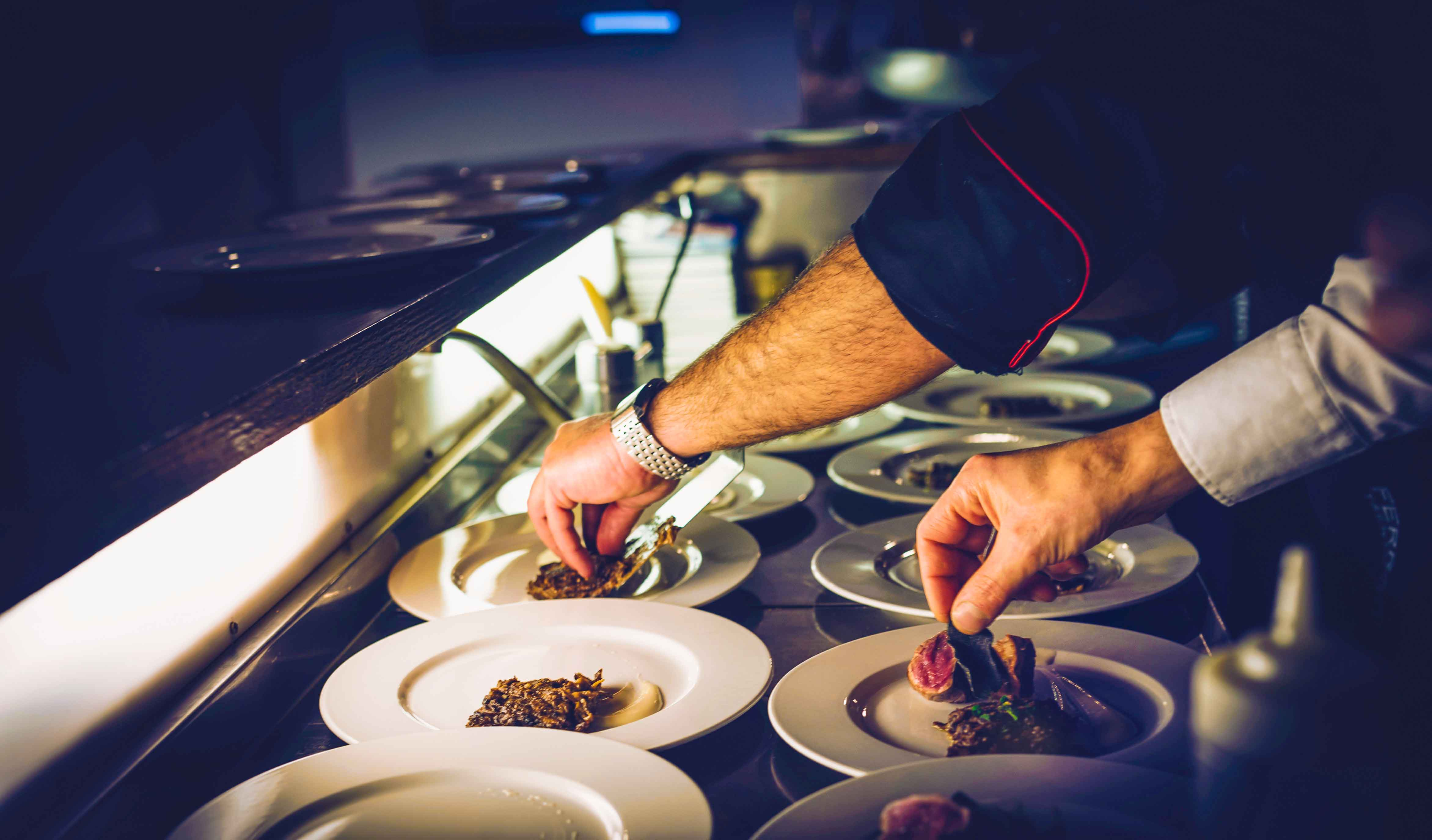 chef preparing dishes in a food and beverage service industry