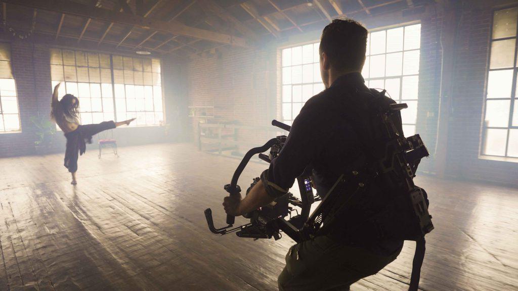 cameraman filming a dancer