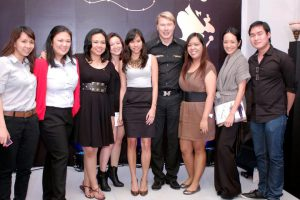 Osmond Go (rightmost) and his female colleagues with Formula One champion Mika Hakkinen