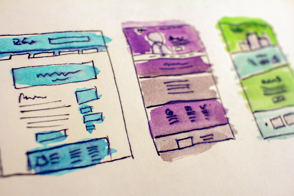 hand-drawn sketches of website wireframes