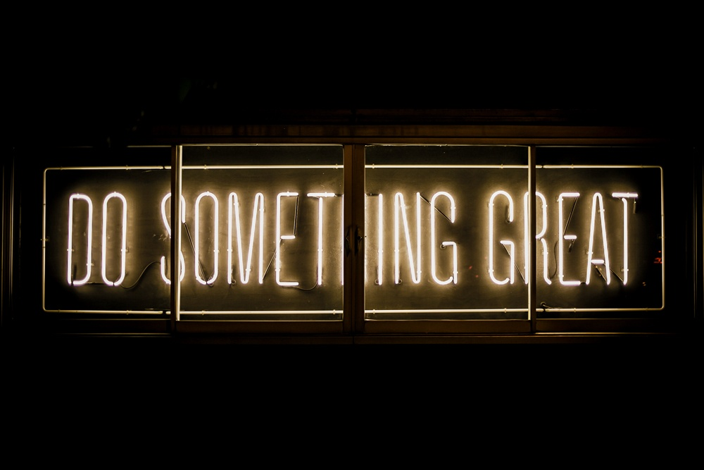 "neon light with ""do something great"" written on it"