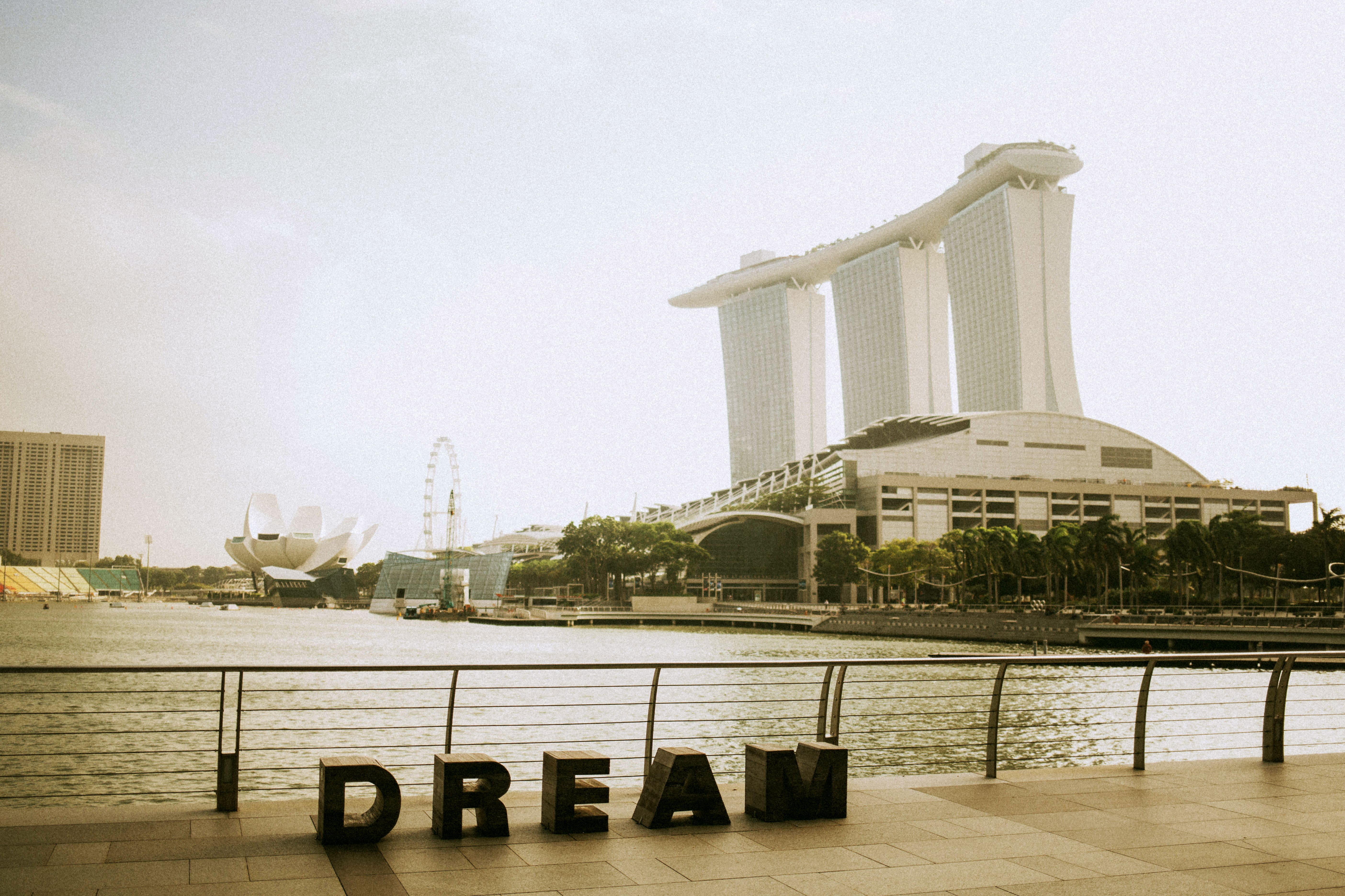 big dream lettering near fence verlooking Marina oBay sands building