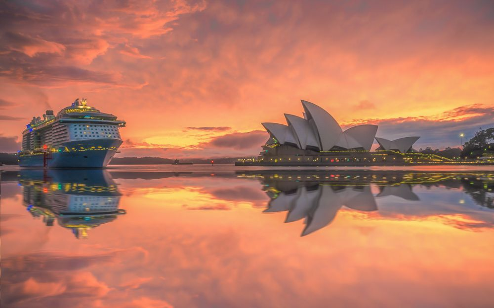 A boat sailing during the sunset in Sydney, Australia