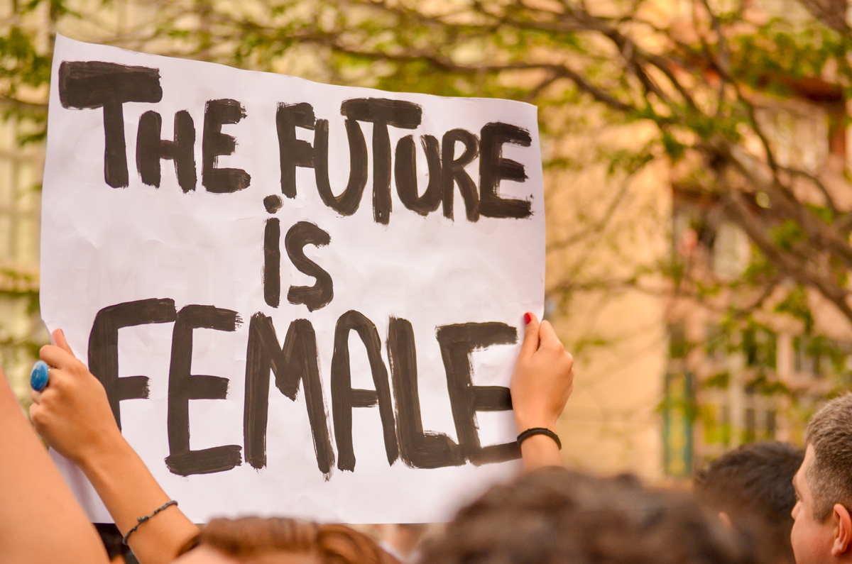 """The Future Is Female"" sign during International Women's Day march"