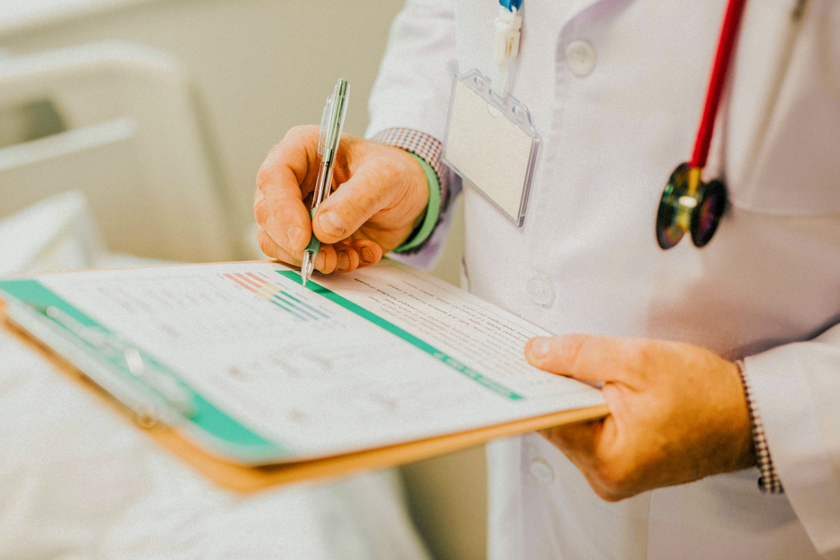 Global Health professional with a medical chart