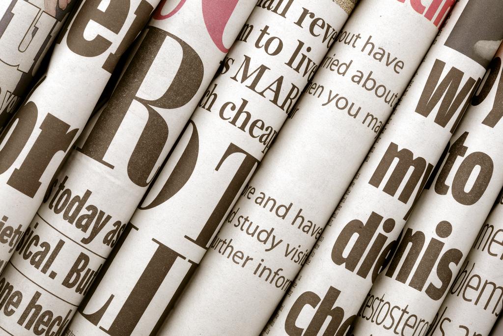 rolls of newspaper headlines