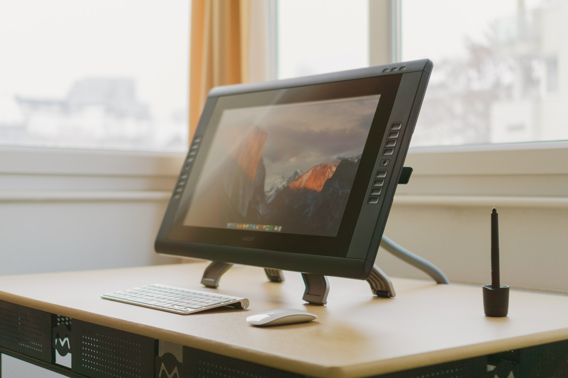 Internships for creative students: a graphic designer's tablet on a desk