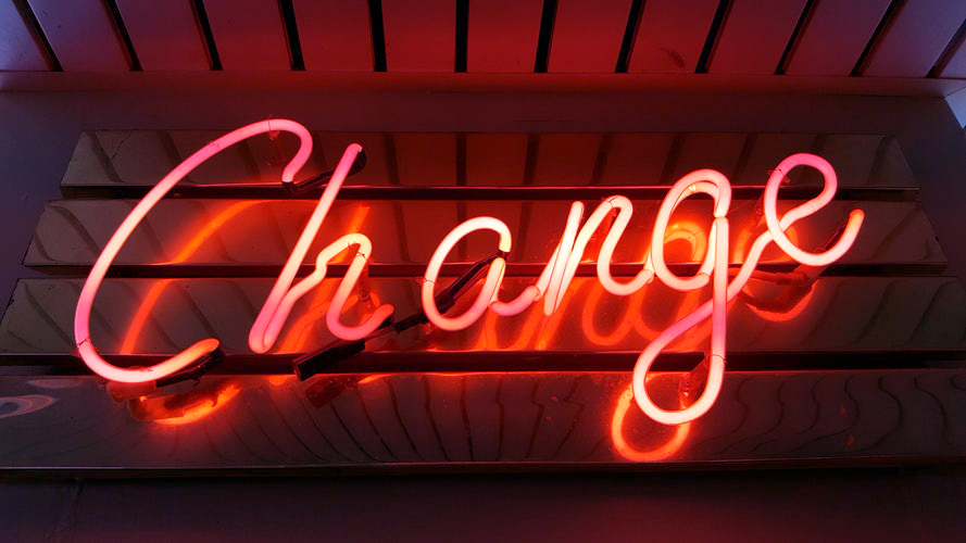 """change"" neon sign"