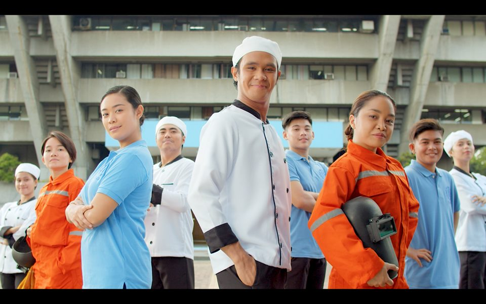 male and female welders, chefs, and other professionals proudly standing