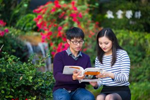 students-reading-a-book-at-city-u